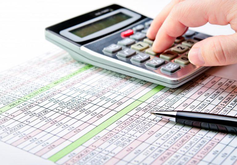 spreadsheet calculator and pen